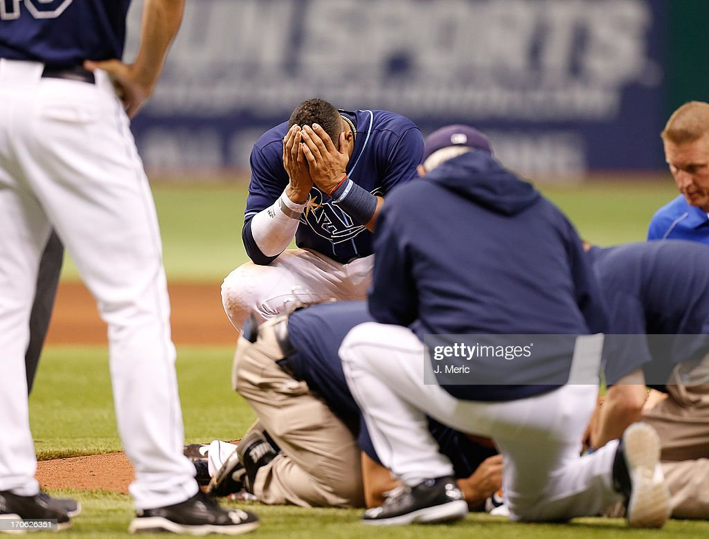 Shortstop <a gi-track='captionPersonalityLinkClicked' href=/galleries/search?phrase=Yunel+Escobar&family=editorial&specificpeople=757358 ng-click='$event.stopPropagation()'>Yunel Escobar</a> #11 of the Tampa Bay Rays reacts after pitcher <a gi-track='captionPersonalityLinkClicked' href=/galleries/search?phrase=Alex+Cobb&family=editorial&specificpeople=7512114 ng-click='$event.stopPropagation()'>Alex Cobb</a> #53 is hit by a line drive against the Kansas City Royals during the game at Tropicana Field on June 15, 2013 in St. Petersburg, Florida.