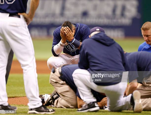 Shortstop Yunel Escobar of the Tampa Bay Rays reacts after pitcher Alex Cobb is hit by a line drive against the Kansas City Royals during the game at...