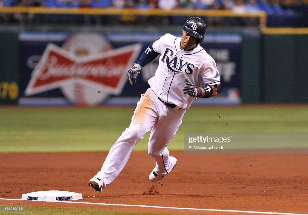 Shortstop Yunel Escobar #11 of the Tampa Bay Rays rounds 3rd base and scores in the 2nd inning against the Los Angeles Angels August 27, 2013 at Tropicana Field in St. Petersburg, Florida.