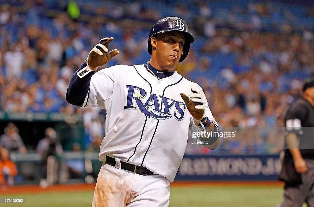 Shortstop <a gi-track='captionPersonalityLinkClicked' href=/galleries/search?phrase=Yunel+Escobar&family=editorial&specificpeople=757358 ng-click='$event.stopPropagation()'>Yunel Escobar</a> #11 of the Tampa Bay Rays scores the tying run in the fifth inning against the Houston Astros during the game at Tropicana Field on July 13, 2013 in St. Petersburg, Florida.