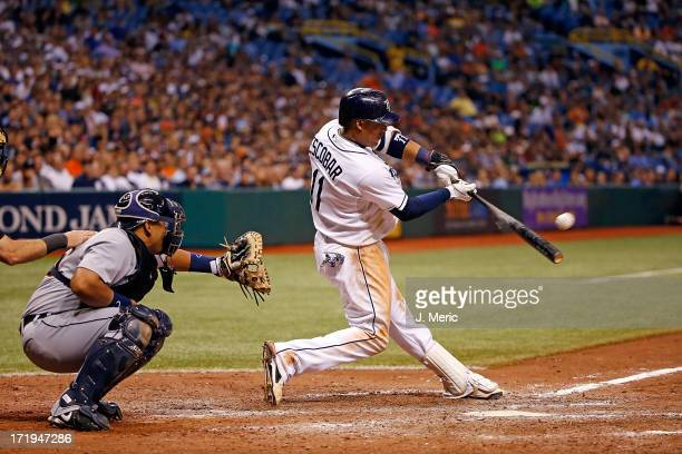 Shortstop Yunel Escobar of the Tampa Bay Rays singles in the winning run in the tenth inning against the Detroit Tigers during the game at Tropicana...