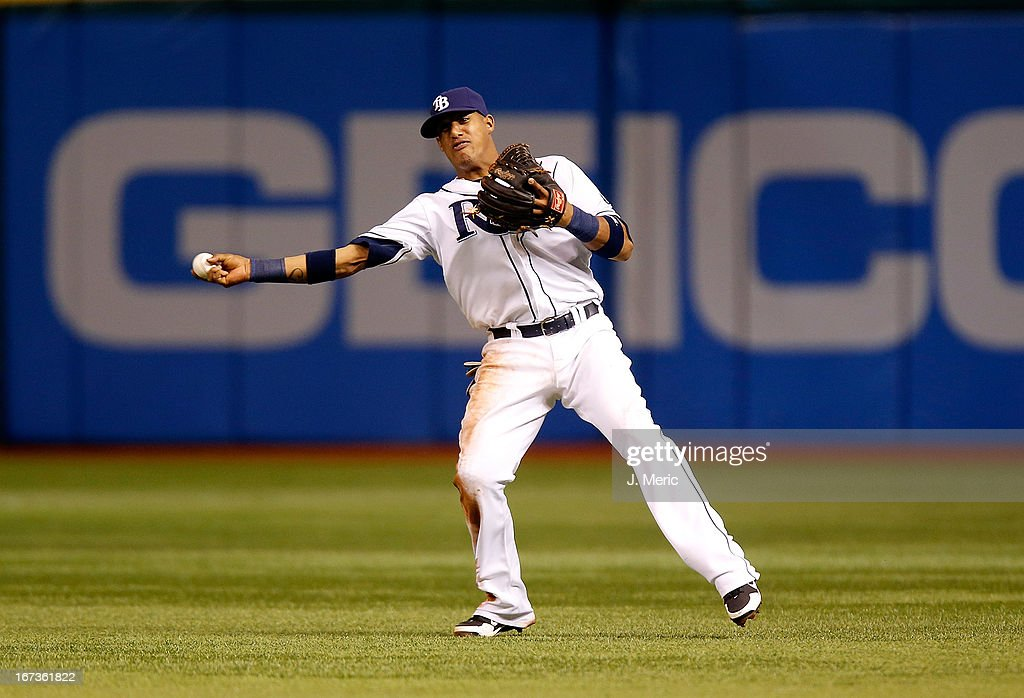 Shortstop <a gi-track='captionPersonalityLinkClicked' href=/galleries/search?phrase=Yunel+Escobar&family=editorial&specificpeople=757358 ng-click='$event.stopPropagation()'>Yunel Escobar</a> #11 of the Tampa Bay Rays throws over to first for an out against the New York Yankees during the game at Tropicana Field on April 24, 2013 in St. Petersburg, Florida.