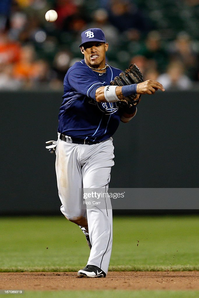 Shortstop Yunel Escobar #11 of the Tampa Bay Rays throws the ball to first base against the Baltimore Orioles at Oriole Park at Camden Yards on April 18, 2013 in Baltimore, Maryland.