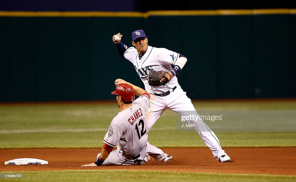 Shortstop <a gi-track='captionPersonalityLinkClicked' href=/galleries/search?phrase=Yunel+Escobar&family=editorial&specificpeople=757358 ng-click='$event.stopPropagation()'>Yunel Escobar</a> #11 of the Tampa Bay Rays turns a double play as <a gi-track='captionPersonalityLinkClicked' href=/galleries/search?phrase=Eric+Chavez&family=editorial&specificpeople=201561 ng-click='$event.stopPropagation()'>Eric Chavez</a> #12 of the Arizona Diamondbacks attempts to break it up during the game at Tropicana Field on July 30, 2013 in St. Petersburg, Florida.