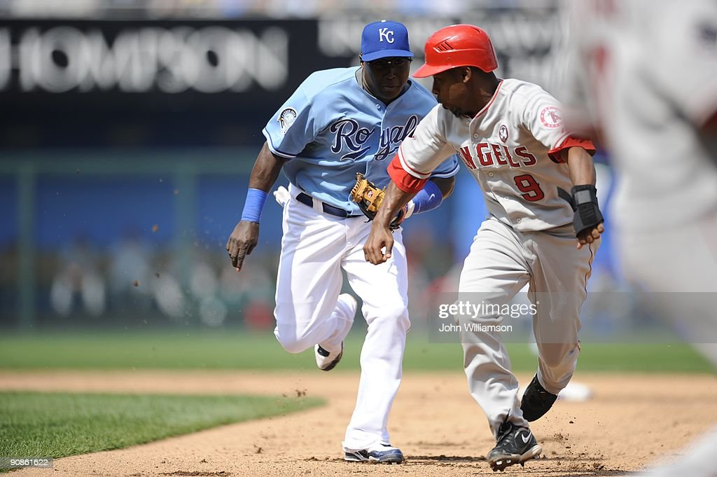 Shortstop Yuniesky Betancourt of the Kansas City Royals fields his position as he runs to tag Chone Figgins of the Los Angeles Angels of Anaheim to...