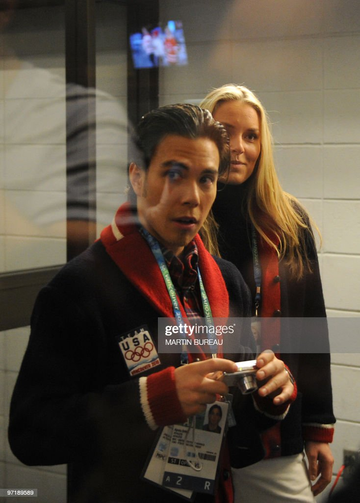 US short-track competitor Appolo Anton Ohno (L) waits backstage with compatriot skier Lindsay Vonn for marching during the closing ceremony at the BC Place in Vancouver, on the last day of the 2010 Winter Olympics on February 28, 2010.