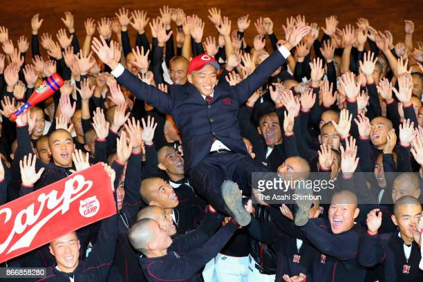 Shosei Nakamura of Koryo High School is thrown into the air by his team mates after picked up by Hiroshima Toyo Carp after the 2017 professional...