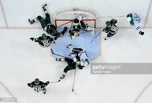 A shot by Alex Goligoski of the Dallas Stars gets past Devan Dubnyk of the Minnesota Wild to score a goal during the third period of Game Six of the...