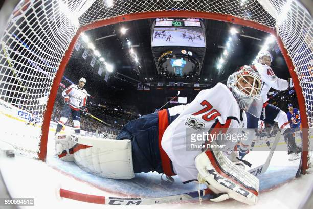A shot by Anders Lee of the New York Islanders enters the net during the first period past Braden Holtby of the Washington Capitals but is later...