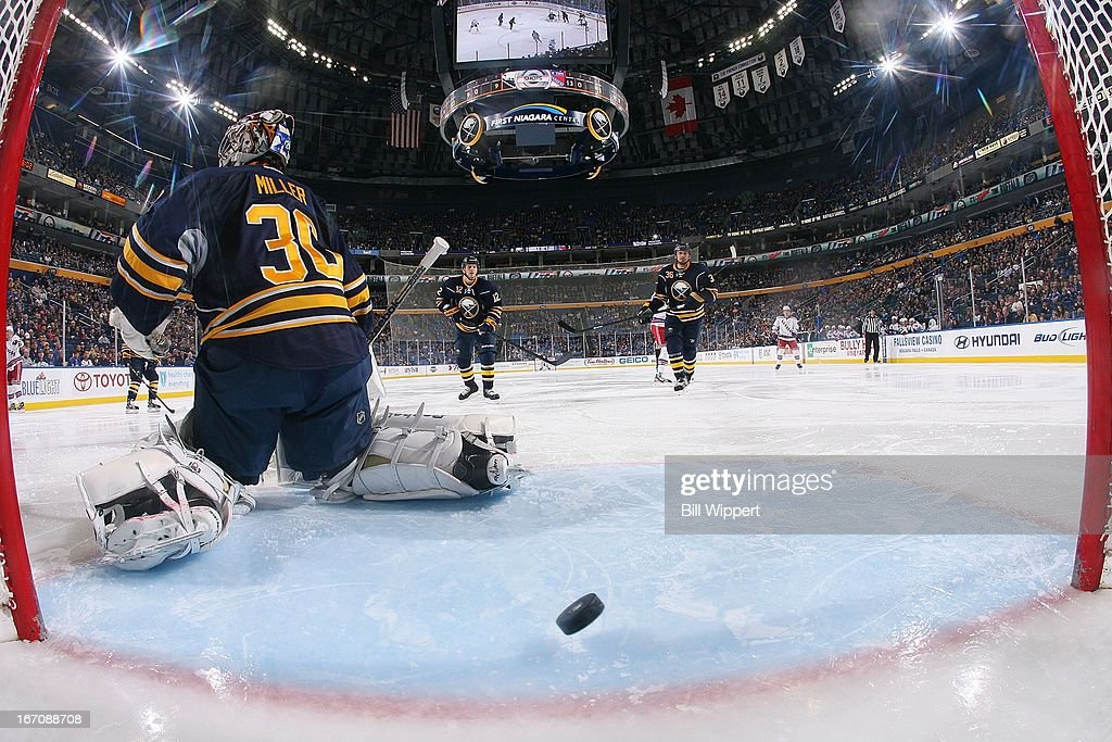 A shot by Anton Stralman (not shown) of the New York Rangers gets by Ryan Miller #30 of the Buffalo Sabres for a goal on April 19, 2013 at the First Niagara Center in Buffalo, New York.
