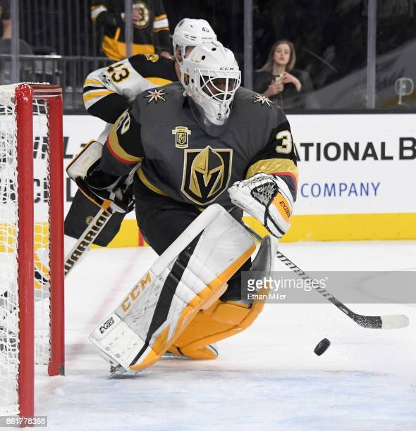 A shot by David Pastrnak of the Boston Bruins gets by Malcolm Subban of the Vegas Golden Knights for a goal in the third period of their game at...