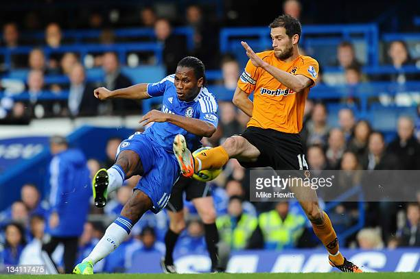 A shot by Didier Drogba of Chelsea is blocked by Roger Johnson of Wolverhampton Wanderers during the Barclays Premier League match between Chelsea...