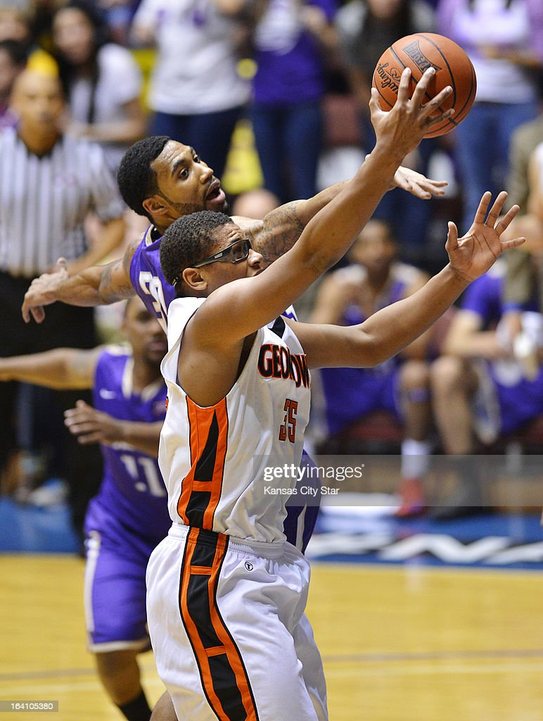 A shot by Georgetown (Ky.) College forward Deondre McWhorter's (35, front) is blocked by Southwestern Assemblies of God University forward Nathaniel Ward (33) in the first half of the NAIA Division 1 men's national championship at Municipal Auditorium in Kansas City, Missouri, Tuesday, March 19, 2013.