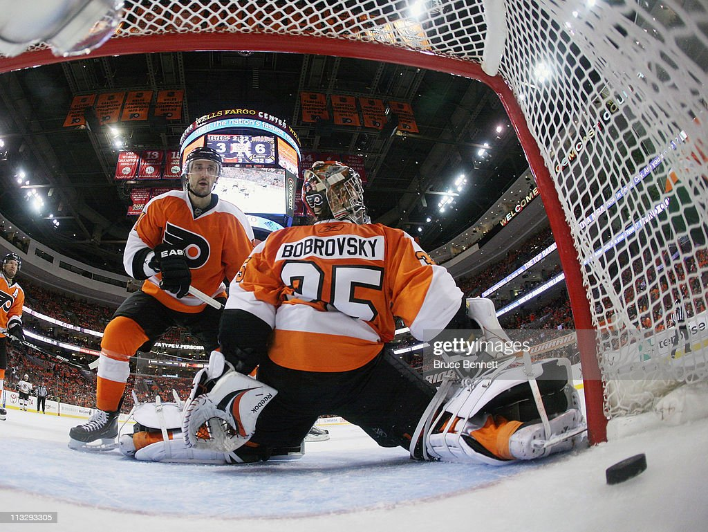 A shot by Gregory Campbell #11 of the Boston Bruins eludes Sergei Bobrovsky #35 of the Philadelphia Flyers late in the third period in Game One of the Eastern Conference Semifinals during the 2011 NHL Stanley Cup Playoffs at the Wells Fargo Center on April 30, 2011 in Philadelphia, Pennsylvania. The Bruins defeated the Flyers 7-3.