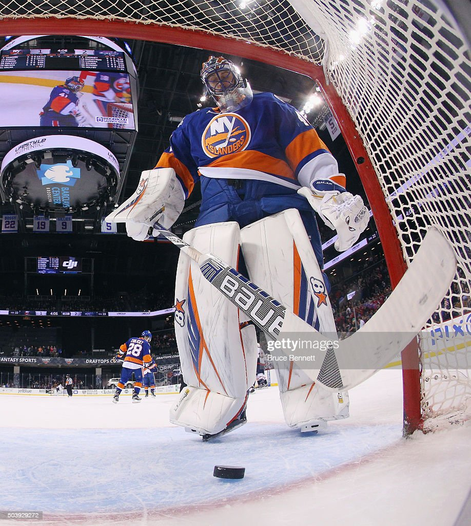 A shot by Nate Schmidt #88 of the Washington Capitals eludes <a gi-track='captionPersonalityLinkClicked' href=/galleries/search?phrase=Jaroslav+Halak&family=editorial&specificpeople=2285591 ng-click='$event.stopPropagation()'>Jaroslav Halak</a> #41 of the New York Islanders at 15:54 of the second periodat the Barclays Center on January 7, 2016 in the Brooklyn borough of New York City.