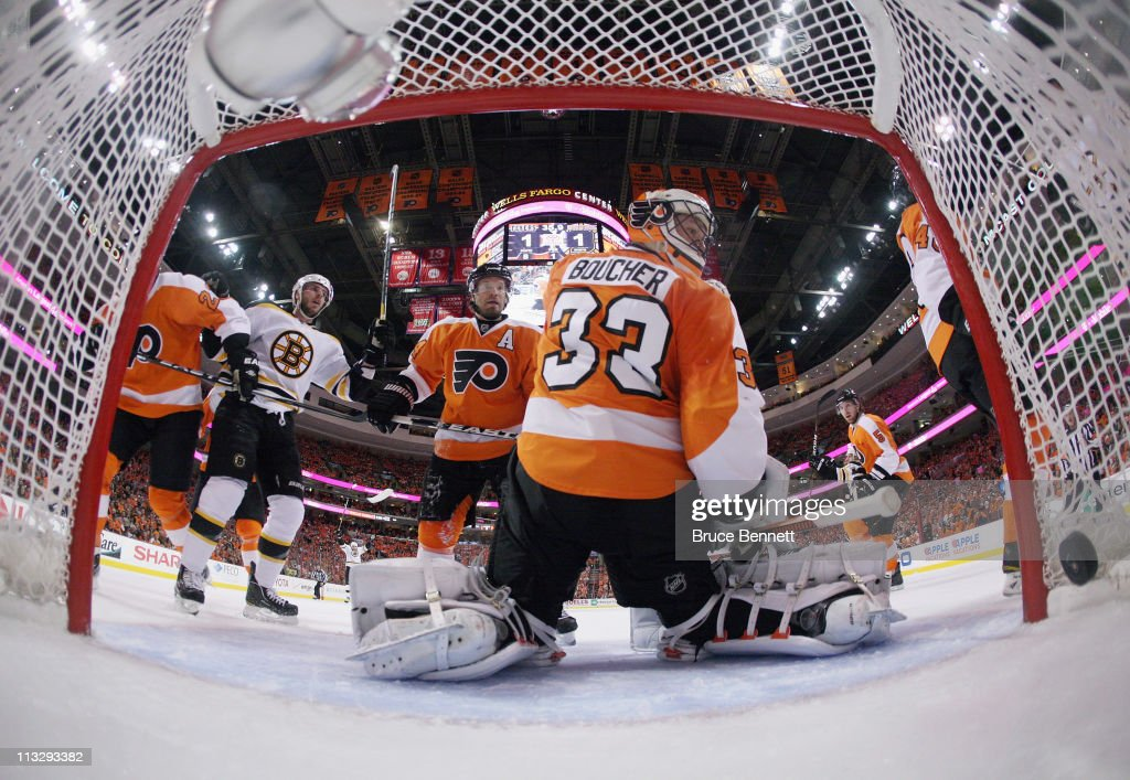 A shot by Nathan Horton #18 of the Boston Bruins (not shown) hits the net at 19:24 of the first period as David Krejci #46 watches on and Kimmo Timonen #44 and Brian Boucher #33 of the Philadelphia Flyers sit defenseless in Game One of the Eastern Conference Semifinals during the 2011 NHL Stanley Cup Playoffs at the Wells Fargo Center on April 30, 2011 in Philadelphia, Pennsylvania. The Bruins defeated the Flyers 7-3.