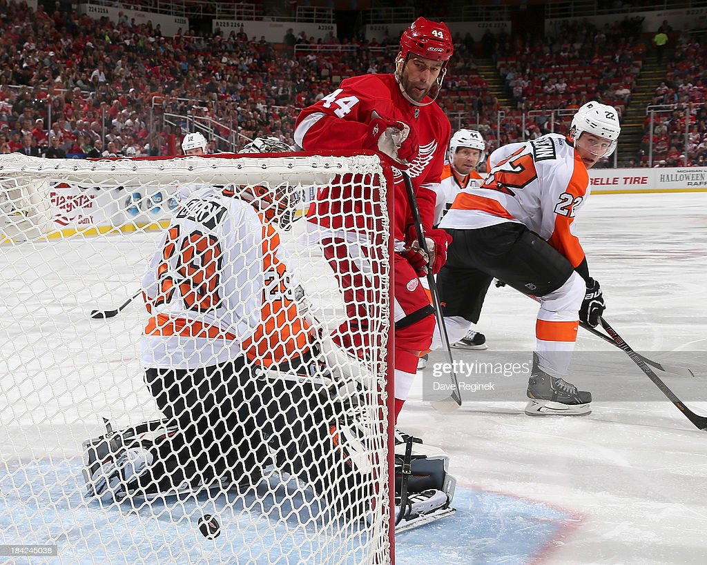 A shot by Pavel Datsyuk #13 of the Detroit Red Wings (not pictured) scores on goalie <a gi-track='captionPersonalityLinkClicked' href=/galleries/search?phrase=Ray+Emery&family=editorial&specificpeople=218109 ng-click='$event.stopPropagation()'>Ray Emery</a> #29 of the Philadelphia Flyers as teammate <a gi-track='captionPersonalityLinkClicked' href=/galleries/search?phrase=Todd+Bertuzzi&family=editorial&specificpeople=202476 ng-click='$event.stopPropagation()'>Todd Bertuzzi</a> #44 screens him during a NHL game at Joe Louis Arena on October 12, 2013 in Detroit, Michigan. Detroit defeated Philadelphia 5-2.