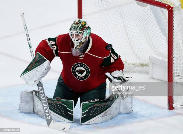 A shot by Tanner Pearson of the Los Angeles Kings deflects off Devan Dubnyk of the Minnesota Wild and into the net to score during the first period...
