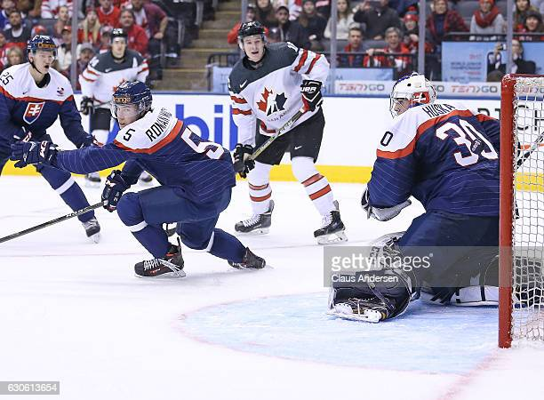 A shot by Thomas Chabot of Team Canada gets past Adam Huska of Team Slovakia during a preliminary game in the 2017 IIHF World Junior Hockey...