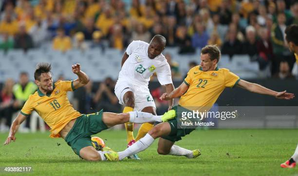 A shot by Tokelo Anthony Rantie of South Africa is blocked by James Holland and Alex Wilkinson of the Socceroos during the International Friendly...