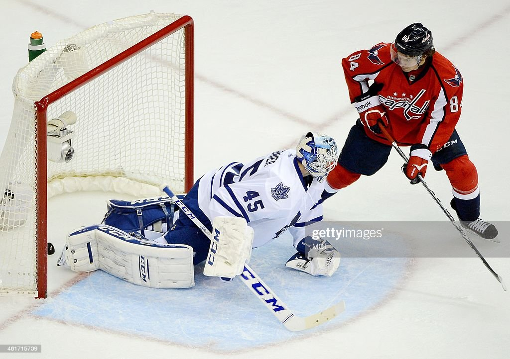 A shot by Washington Capitals right wing Joel Ward (42), not pictured, beats Toronto Maple Leafs goalie Jonathan Bernier (45) for the game-winning goal, as Capitals center Mikhail Grabovski (84) looks for a possible rebound, in the third period at the Verizon Center in Washington, Friday, Jan. 10, 2014. The Capitals defeated the Maple Leafs, 3-2.