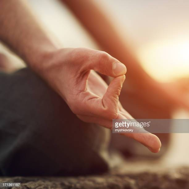 Shot focused on hands of a person doing yoga exercise