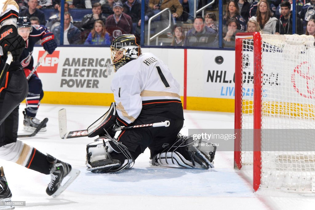 A shot from Mark Letestu #10 of the Columbus Blue Jackets goes past goaltender <a gi-track='captionPersonalityLinkClicked' href=/galleries/search?phrase=Jonas+Hiller&family=editorial&specificpeople=743364 ng-click='$event.stopPropagation()'>Jonas Hiller</a> #1 of the Anaheim Ducks for an overtime goal on March 31, 2013 at Nationwide Arena in Columbus, Ohio. Columbus defeated Anaheim 2-1 in overtime.