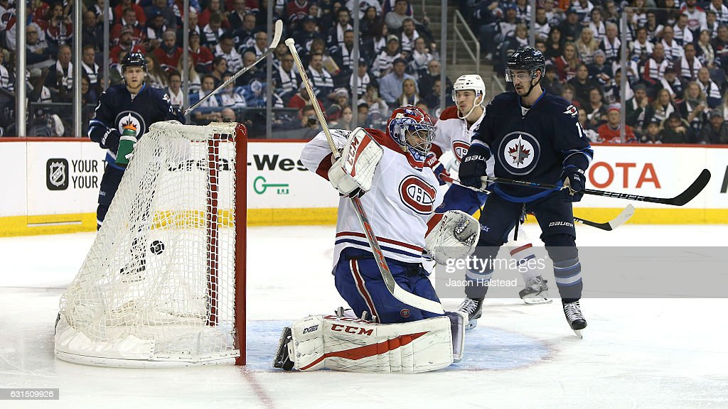 A shot from Mark Scheifele #55 (not pictured) of the Winnipeg Jets beats Al Montoya #35 of the Montreal Canadiens during NHL action on January 11, 2017 at the MTS Centre in Winnipeg, Manitoba.