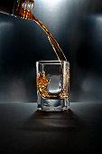 Shot glass drink on black