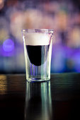 Shot glass with Kahlua coffee liqueur flavor. With cream on top.