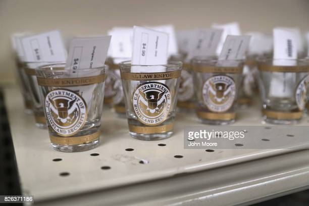 Shot glasses await sale in a souvenir shop at the Federal Law Enforcement Training Center on August 2 2017 in Artesia New Mexico The US Border Patrol...