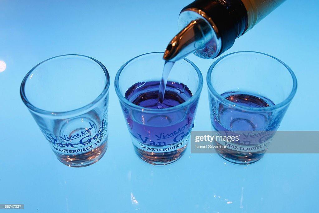 Shot glasses of flavored vodka are poured at the Barman's 2009 drinks fair on June 29 2009 in Tel Aviv Israel Despite the downturn in the economy...
