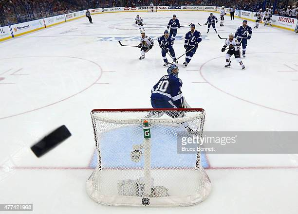 A shot goes up over Ben Bishop of the Tampa Bay Lightning during the game against the Chicago Blackhawks during Game Five of the 2015 NHL Stanley Cup...