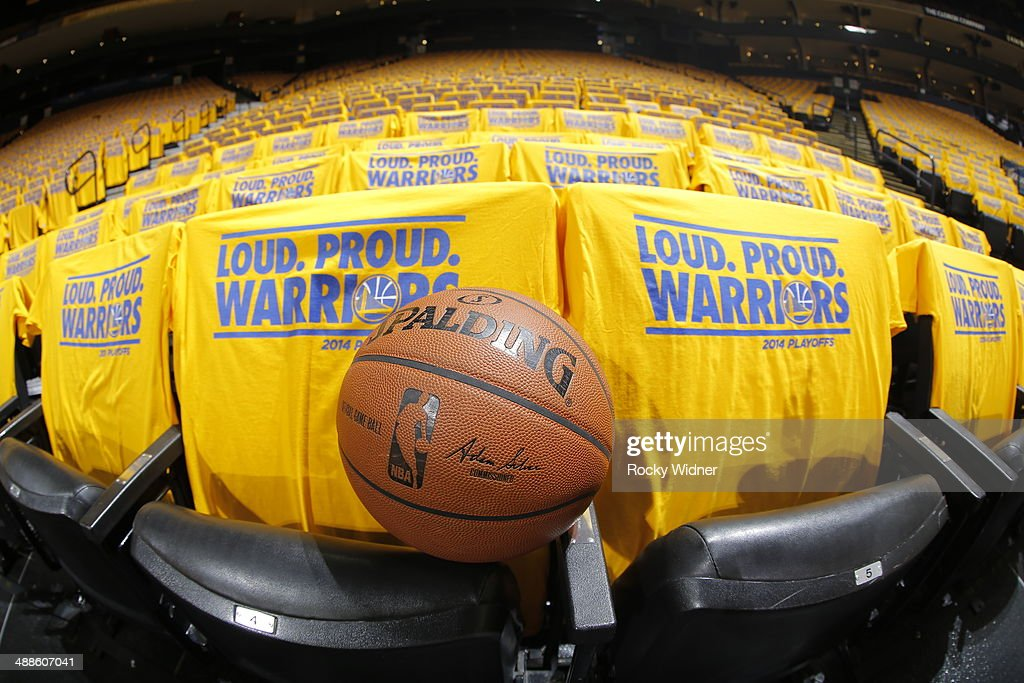 A shot of a basketball among the tshirts covering the seats of Oracle Arena prior to the game between the Los Angeles Clippers and Golden State Warriors in Game Six of the Western Conference Quarterfinals during the 2014 NBA Playoffs at Oracle Arena on May 1, 2014 in Oakland, California.