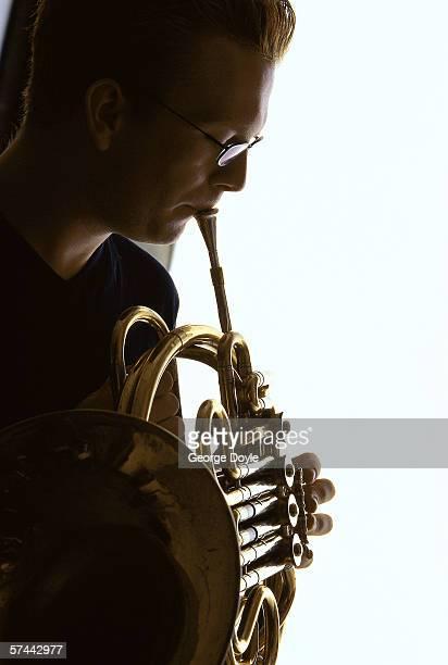 shot of a man playing a brass wind instrument