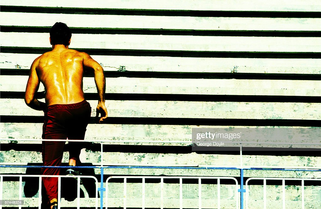 shot of a man running up stairs