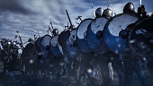 Shot of Advancing Army of Viking Warriors. Medieval Reenactment.
