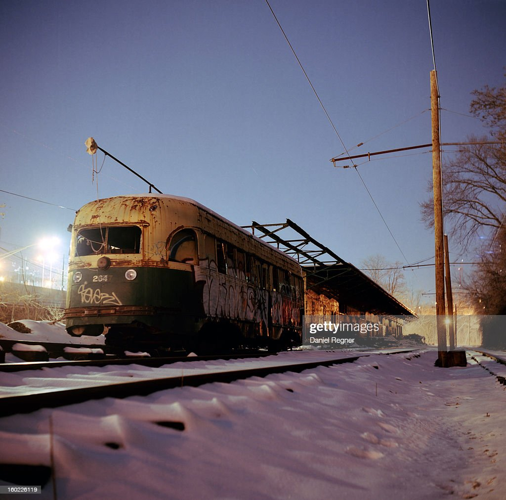 CONTENT] A shot of an old rusted train on the train tracks, out of commission and use for many years. It is gathering rust in the snow and winter cold. Graffiti can be seen painting the side. An old look into baltimore history.