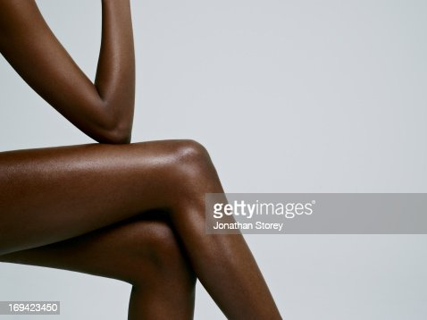 Shot of females crossed legs and arm
