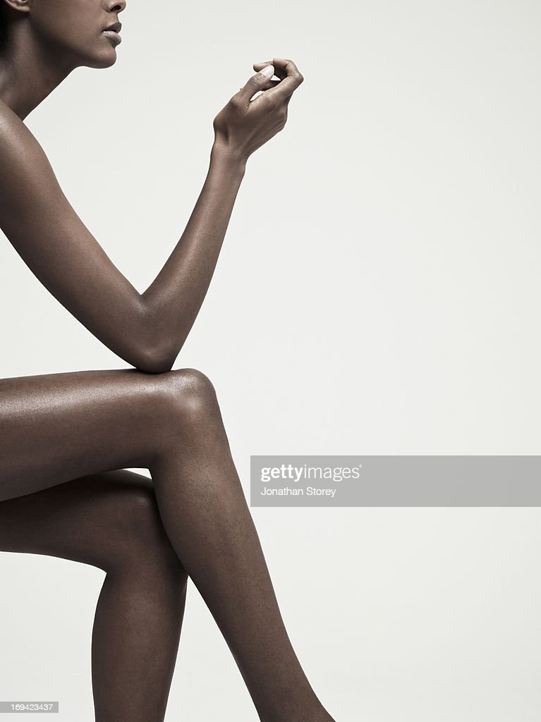 shot of females crossed legs arm and side of face : Stock Photo