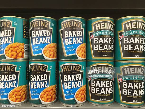 A shot of Heinz baked beans on a shelf at a local store
