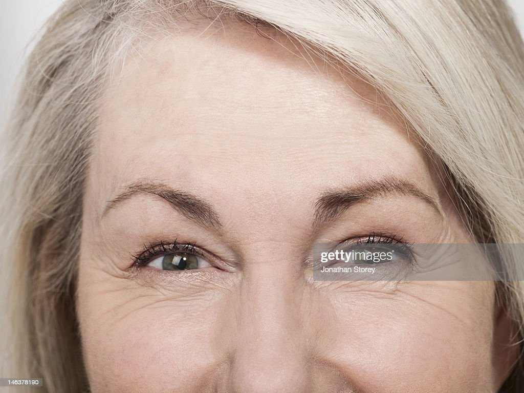 Shot of mature womans green eyes : Stock Photo