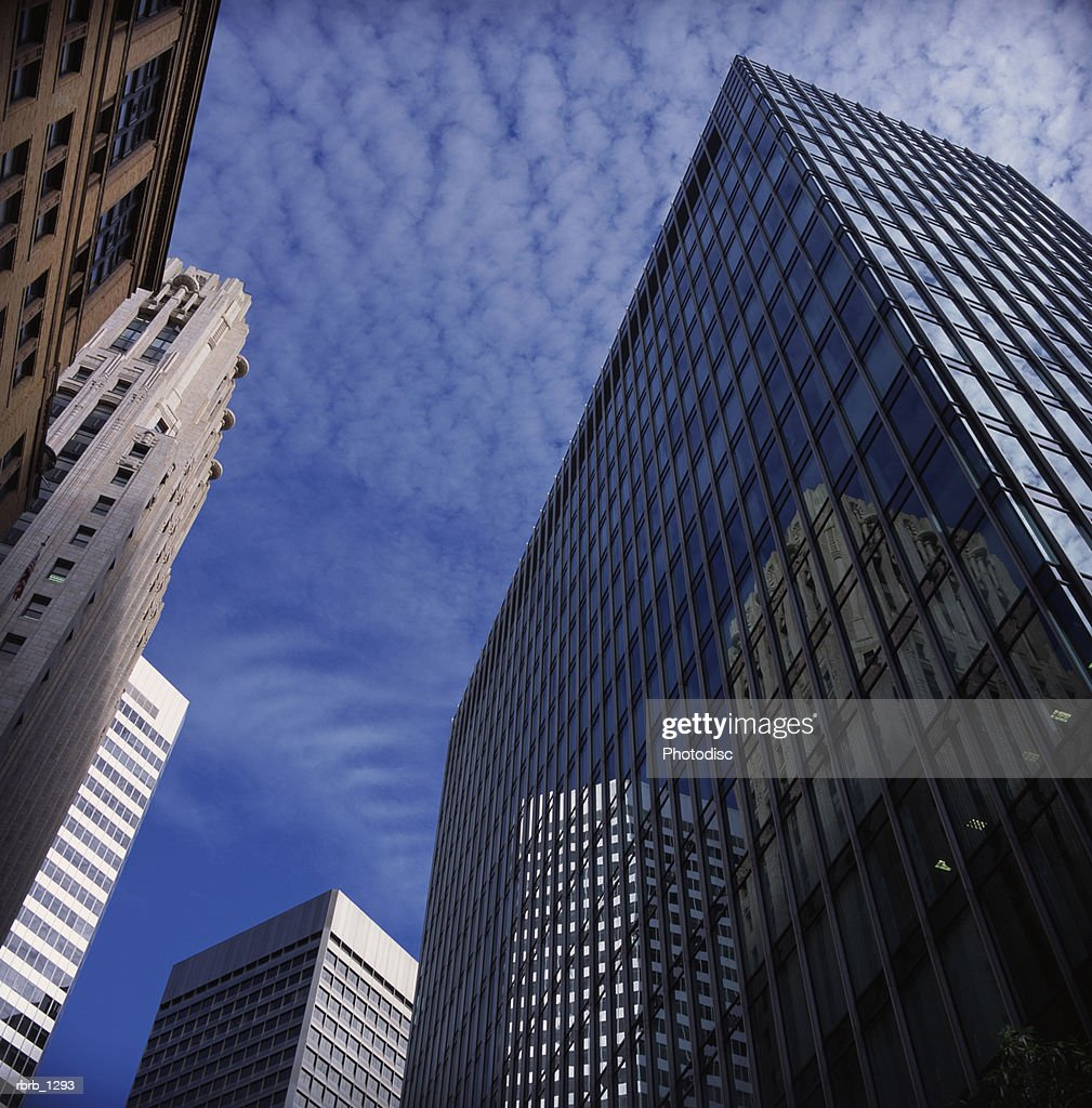 shot of tall office buildings and a nice blue sky : Stock Photo
