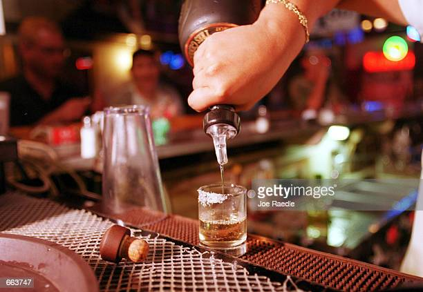 A shot of tequila is poured September 28 2000 at La Hacienda in El Paso Texas Up to 40 percent of the firms making Mexico's tequila may halt...