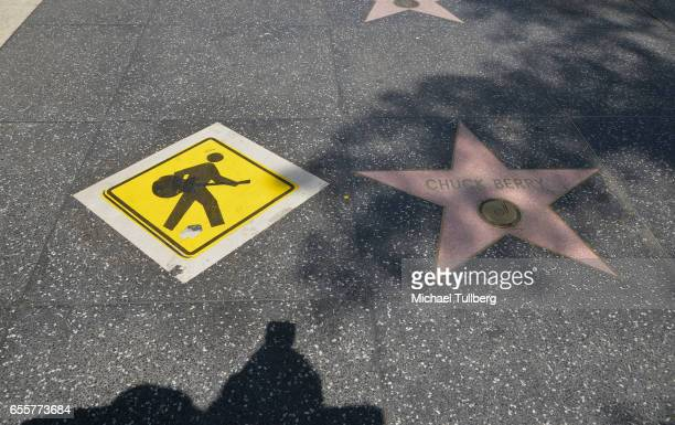 Shot of the late Chuck Berry's star accompanied by street art on the Hollywood Walk of Fame on March 20 2017 in Hollywood California