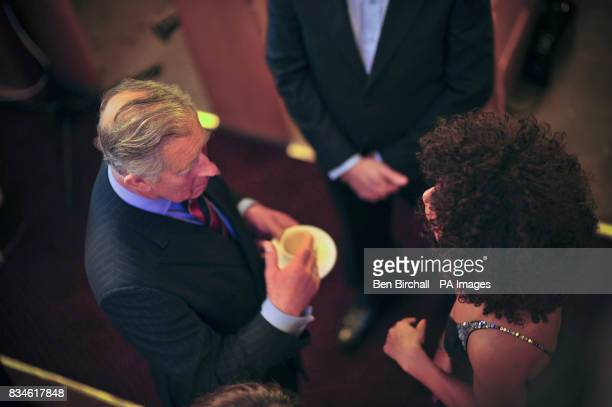 A shot of the The Prince of Wales from above as he chats to actress Rosalind Richards who was one of the first artists to record at the Canolfan...