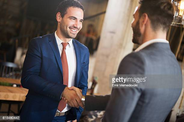 Shot of two businessmen shaking hands.