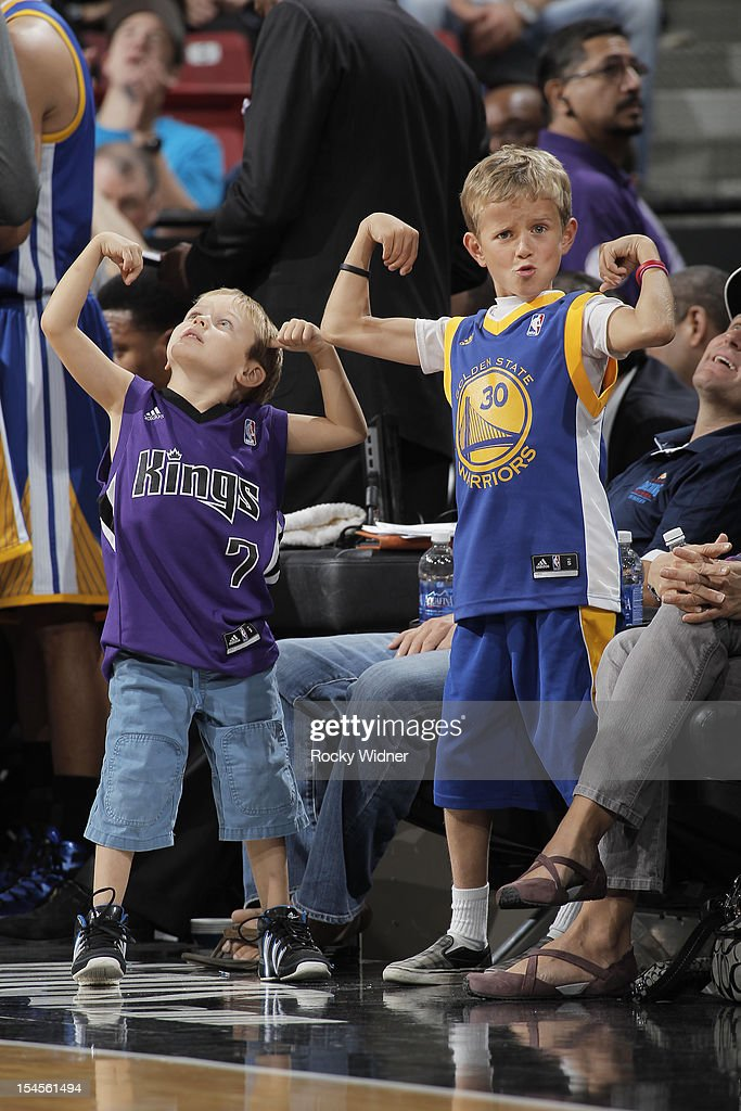 A shot of two fans flexing during the game between the Sacramento Kings and Golden State Warriors on October 17, 2012 at Power Balance Pavilion in Sacramento, California.
