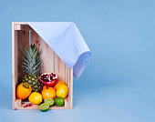 Shot of various fruit in wooden crate