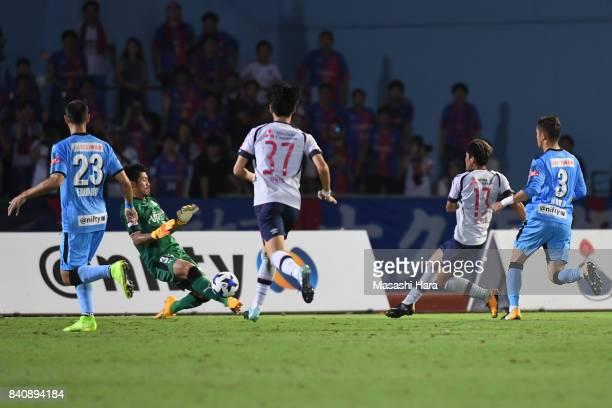 Shota Arai of Kawasaki Frontale saves the shot of Yoshito Okubo during the JLeague Levain Cup quarter final first leg match between Kawasaki Frontale...